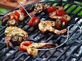 Scampi and vegetable kebabs on a grill with a garlic marinade