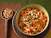 Spicy white cabbage with tomatoes and peanuts
