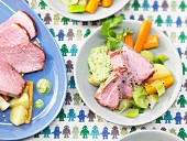 Roast gammon with fresh vegetables and herb sauce