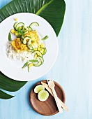 Curried fish on a bed of rice with a mango and cucumber salad