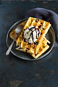 Belgian waffles with vanilla ice cream and chocolate sauce