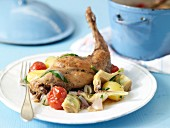 Braised rabbit leg with artichoke hearts and potatoes