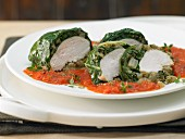 Chicken breast wrapped in chard on tomato sugo