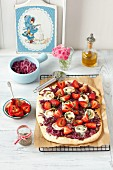Pizza with caramelized red onions, goat's cheese and strawberries