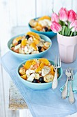 Fish salad with baked cod, black olives, celery, orange, beans and croutons