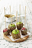 Toffee apples with sesame seeds, sunflower seeds and poppy seeds