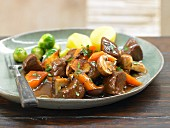 Marinated venison goulash with mushrooms and brussel sprouts