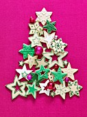 Colourful Christmas star biscuits in the shape of a Christmas tree