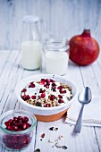 Muesli with pomegranate, yoghurt and almonds
