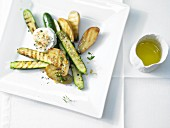 Grilled courgette and new potatoes with goats' cheese medallions