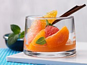 Citrus fruits in spicy syrup with mint
