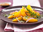 Orange salad with rocket and red onion
