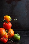 Various tomatoes against a black background