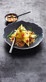 Cheese & potato ravioli with tomato & tarragon butter