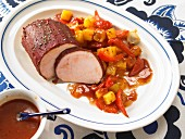 Roast pork with a tomato crust and potatoes with red pepper