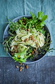 A fennel and mizuna salad with dried white mulberries (superfood)