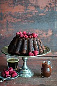 Moist chocolate cake with ganache and fresh raspberries