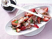 Savoury strawberries with ham and balsamic and honey syrup