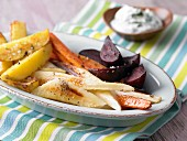 Colourful roasted vegetables with a dip