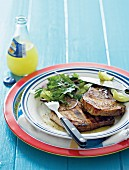 Marinated and grilled pork chops with coriander leaves