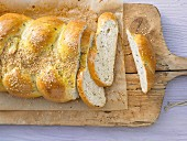 A savoury sesame seed yeast plait with olives and rosemary
