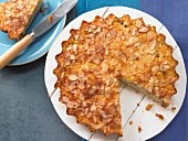 Rice pudding & rhubarb tart with flaked almonds