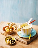 Cheese & wine fondue with bread, potato and gherkins