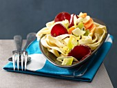 Pasta nests with beetroot and carrots
