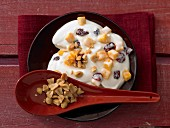 Coconut and mango quark with cranberries and peanuts