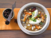 Oriental vegetable soup with chickpeas, coriander and cream cheese dumplings