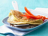 Cheese omelette with red pepper on wholemeal bread