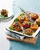 Pepper halves stuffed with roast vegetables, barley and feta cheese