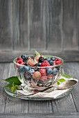 Fresh berry salad with chia seeds and mint