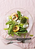 A salad with nectarine, feta and basil & mint dressing