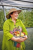 The tomato grower Irina Zacharias in a greenhouse