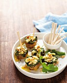 Mushrooms filled with with spinach, feta, pesto and pine nuts