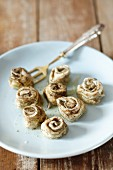 Herring rolls with herbs and black pepper
