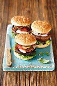 Hamburgers with grilled portobello mushrooms, mozzarella, bacon, courgette and tomato