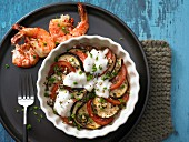 Tomato and aubergine gratin with marinated prawns