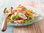 Seafood salad with tomato, yellow pepper and celery