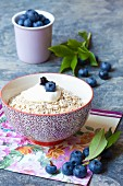 Porridge oats with cream and blueberries