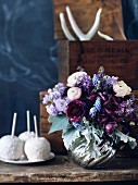 Bouquet in silver vase on rustic wooden table
