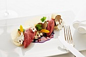 Pigeon with truffle and red cabbage