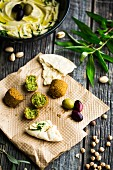 A dish with old biblical ingredients: falafel, flatbread, olives, pistachios and hummus