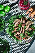 A large bowl of Thai Grilled Beef and Herb Salad