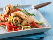 Plaice rolls on a bed of peppers