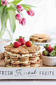 A waffle cake with advocaat cream and strawberries