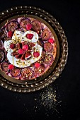 Fig upside-down cake with raspberries, pistachio nuts, cream, yoghurt and honey