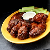 Smoked chicken wings with ranch dressing and celary