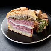A muffuletta sandwich with olive tapenade